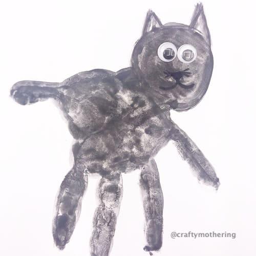 fun halloween activity for kids black cat handprint